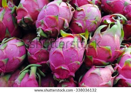 Dragonfruit, or pitaya, the fruit of a tropical cactus, displayed at an outdoor market. Some people experience allergic reactions to this fruit.
