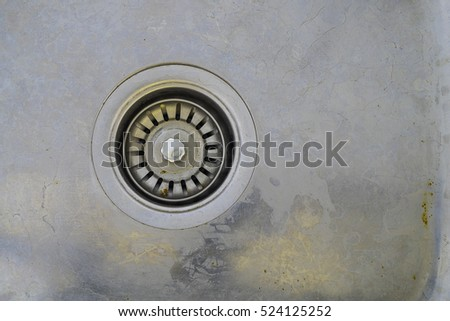 drain hole in the dirty sink