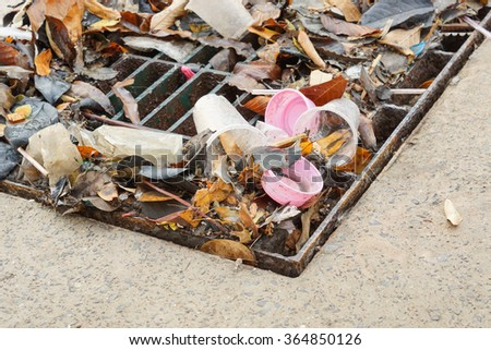 drain lid covered with garbage causing flood