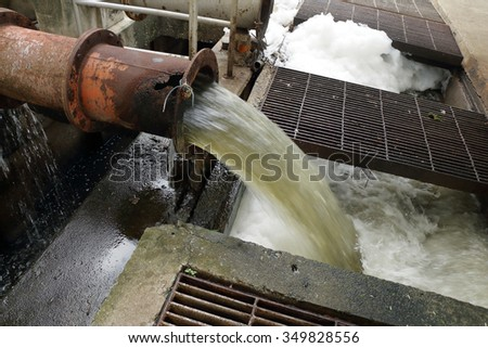 Drain make the foam on dirty water surface - stock photo