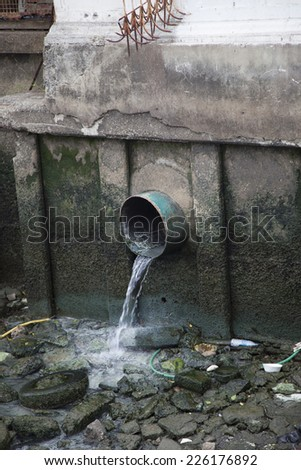 Drain water and allow to drain into the canal. - stock photo