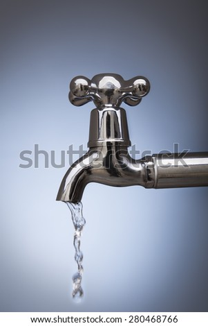 drain water from the tap Metal - stock photo