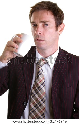 drained looking business man taking a coffee break - stock photo