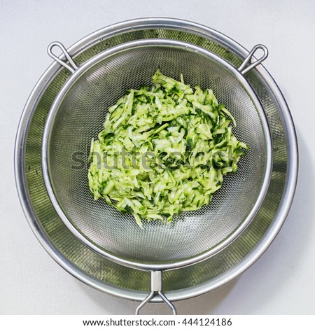 Draining Grated Cucumber in a Sieve