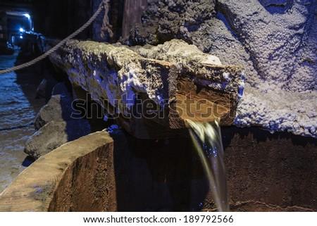 Draining water in the salt mine - stock photo