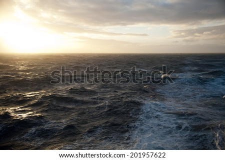 Drake passage at sunset on a cruise to Antarctica not that rough sea - stock photo