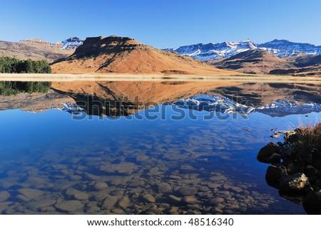 Drakensberg Mountains and trout lake - stock photo