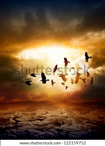 Dramatic apocalyptic background, mayan end of world, red sunset, armageddon, hell, big explosion, flock of flying ravens, crows in dark sky - stock photo