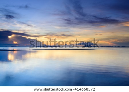 Dramatic  beach  sunset with colorful sky background - stock photo