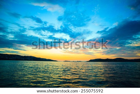 Dramatic beautiful sunset cloudy sky above a surface of the sea. Bergen, Norway - stock photo