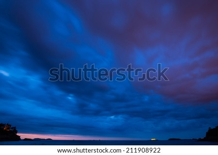 Dramatic blue cloudy sky sunset over the coast of Dinard, France. - stock photo