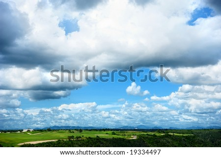 Dramatic Blue Sky over golf course - stock photo