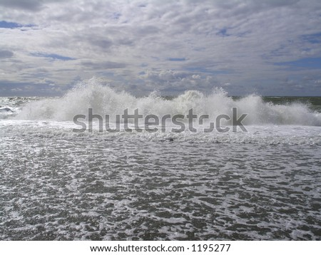 Dramatic braking waves creating lots of surf and foam. Bovbjerg at the West-coast of Jutland, Denmark. - stock photo