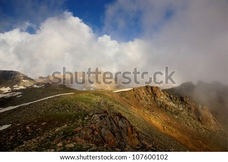 Dramatic clouds and fog in high mountains