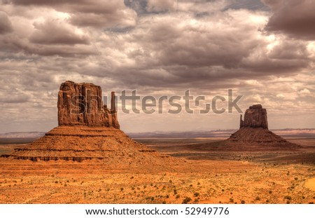 Dramatic Clouds over Buttes at Monument Valley - stock photo