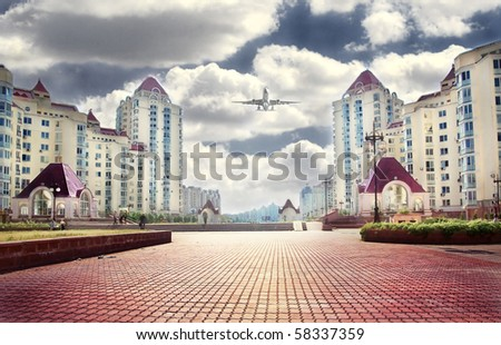 Dramatic clouds over row of typical residential houses.Kiev,Ukraine - stock photo