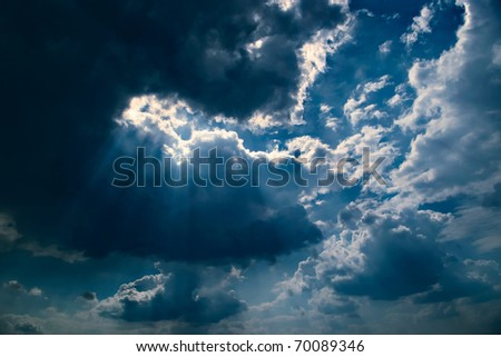 dramatic dark sky with clouds and light - stock photo
