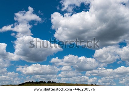 Dramatic deep blue sky with white clouds