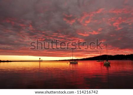Dramatic evening skies over Grand Marais, MN - stock photo