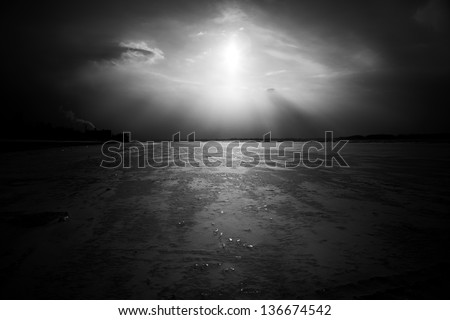 Dramatic frozen river landscape, black and white - stock photo