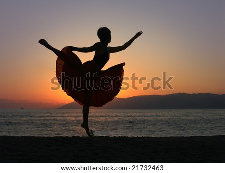 Dramatic image of a woman dancing by the ocean at sunset, silhouette - stock photo