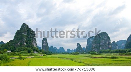 Dramatic landscape of karst mountains under a coming storm in southern china - stock photo