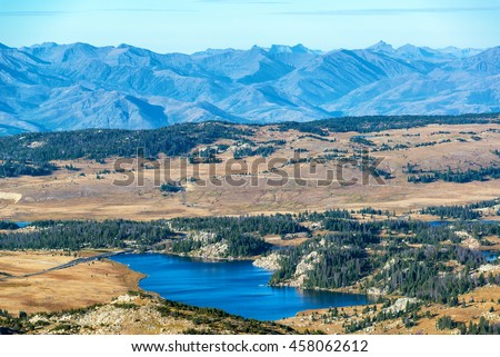 Dramatic landscape with a lake and Beartooth Mountain Range in Montana and Wyoming - stock photo