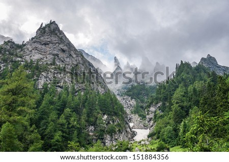 Dramatic landscape with clouds and fog in the mountains