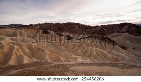 Dramatic Light Badlands Amargosa Mountain Range Death Valley Zabriskie Point - stock photo