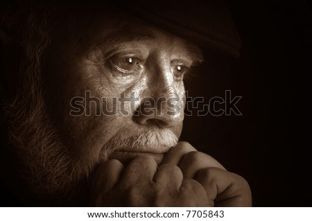 Dramatic portrait of a elderly man contemplating retirement