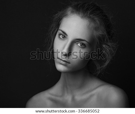 Dramatic portrait of a girl theme: portrait of a beautiful girl on a dark background, black and white photography