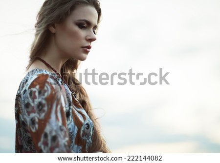 Dramatic portrait of beautiful hippie girl outdoors. Boho fashion style - stock photo