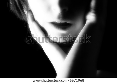 Dramatic portrait of thirty something woman's mouth in black and white.