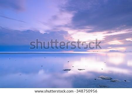 Dramatic rain cloud,sea and sky at dusk.Long exposure technique - stock photo