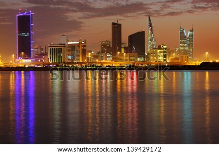 Dramatic reflection of light of Bahrain highrise, HDR photograph - stock photo