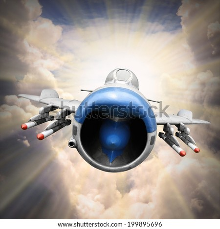 Dramatic scene on the sky. Old jet fighter plane inbound from sun. Retro technology background.  - stock photo