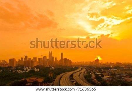 Dramatic scenery of the city center at sunset - stock photo