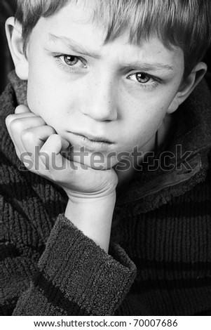 dramatic shot of a young boy in black and white