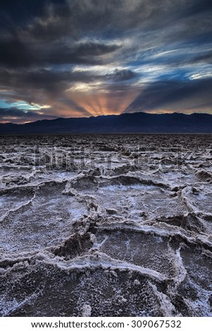 Dramatic skies at sunset over Badwater at Death Valley National Park.