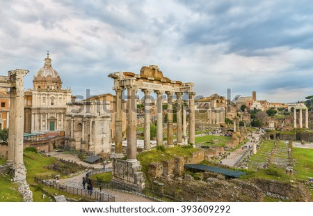 Dramatic sky above Roman Forum and Colosseum (Coliseum, Colosseo) in sunset time. Beautiful architectural and natural landscape. Panoramic view on the  famous touristic landmark. Rome. Italy. Europe. - stock photo
