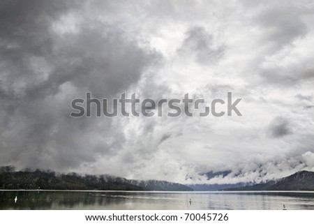 Dramatic Sky against the mountains - stock photo