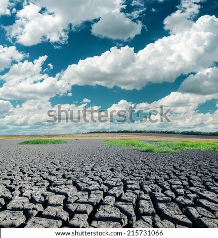 dramatic sky and cracked earth - stock photo