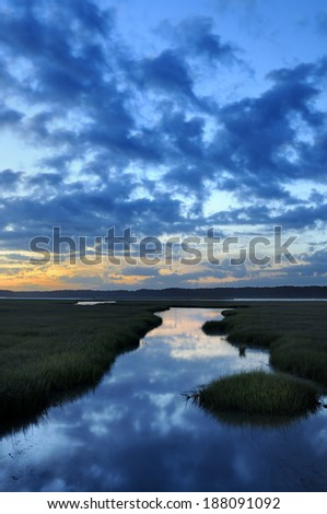 Dramatic Sky and Reflections at Twilight - stock photo