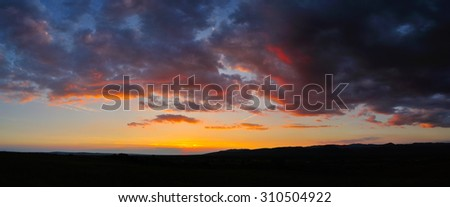 Dramatic sky at sunset with red, yellow and orange colors. - stock photo