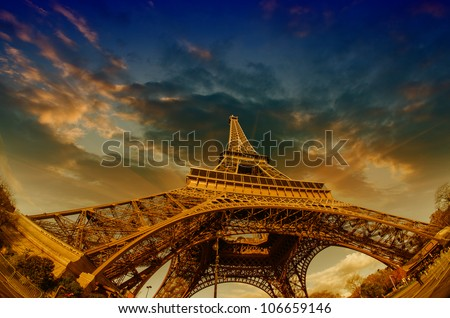Dramatic Sky Colors above Eiffel Tower in Paris, France - stock photo