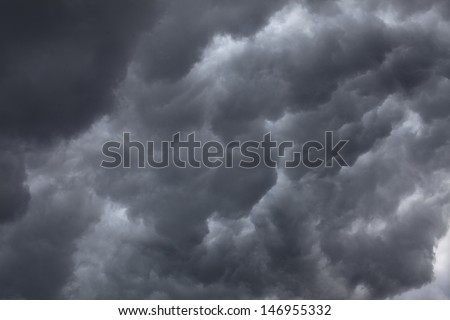 Dramatic Sky of Dark Storm Clouds - stock photo