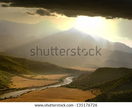 dramatic sky on the valley of the Vjosa River at the sunset, Albania - stock photo