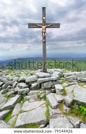 Dramatic sky over a Cross on a Lusen peak (1373m) in national park Bavarian Forest. Germany, Europe. - stock photo