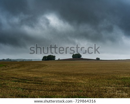 dramatic sky over a field