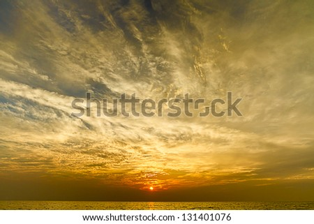 Dramatic sky over a lake - stock photo